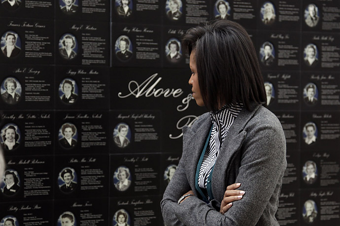 First Lady Michelle Obama looks at a display during a tour of Arlington National Cemetery's Women in Military Service for America Memorial Center in Virginia.