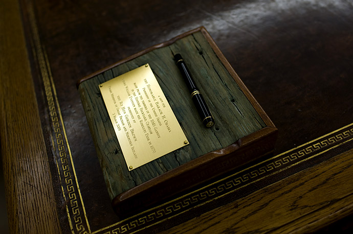 A pen given to President Obama by British Prime Minister Gordon Brown sits on the President's desk in the Oval Office. The ornamental pen holder made from the timbers of the HMS Gannet