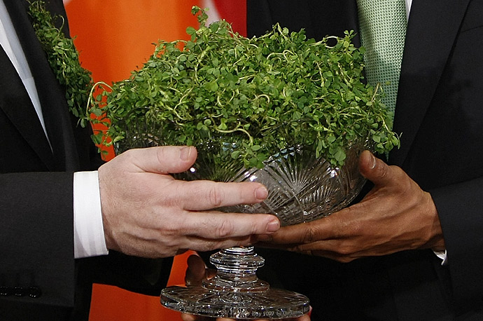 President Barack Obama receives a bowl of shamrocks from Irish Prime Minister Brian Cowen in the Roosevelt Room of the White House.