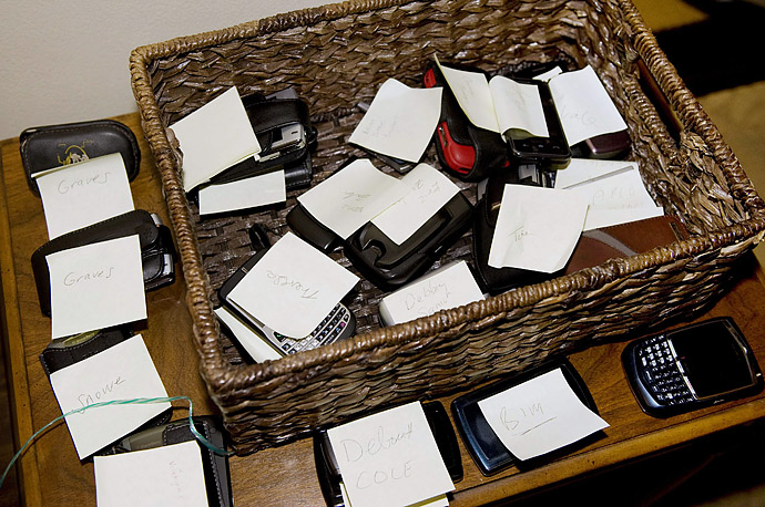 Cell phones sit inside basket outside the Roosevelt Room as President Barack Obama and Secretary of Treasury Timothy Geithner meet with small business owners, community lenders,
