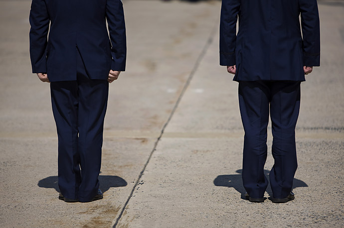 US military personnel stand at attention as President Obama arrives at Andrews Air Force Base.