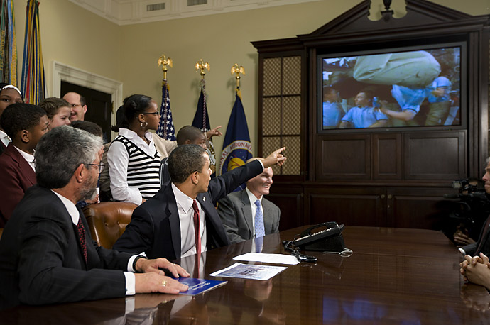 President Barack Obama, members of Congress and visting school children talk to astronauts on the International Space Station, from the Roosevelt Room of the White House.