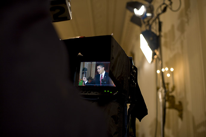 President Barack Obama appears on a television camra monitor during his Tuesday night news conference.