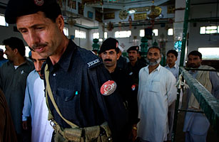 Pakistani police officers in a shrine in Buner, Pakistan, on April 18, 2009