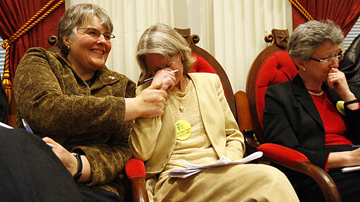 Gay marriage advocate Beth Robinson, center, holds back tears following the ...