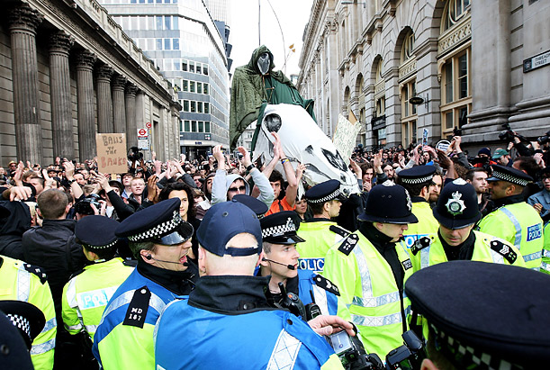 Protesters advancing down Threadneedle Street meet police lines during G-20 demonstrations outside the Bank of England