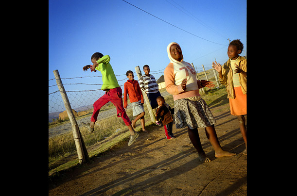 Children play in the sunset, Mvezo