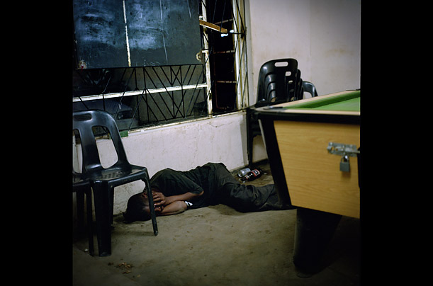 A man lies unconscious on the floor of a bar in downtown Mthatha,