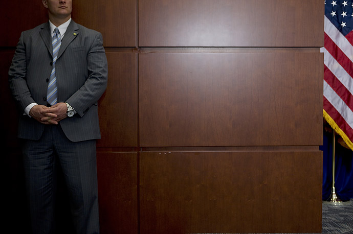 A man listens to President Barack Obama speak at the Department of Transportation in Washington D.C.