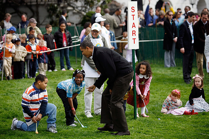 President Barack Obama checks to see if everyone is ready at the start of the White House Easter Egg Roll.