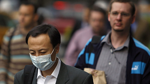 A man wears a medical mask during the morning commute in New York, April 29, 2009.