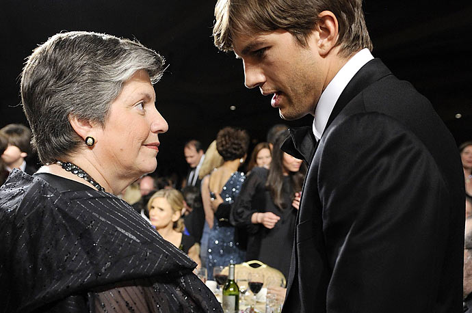 Actor Ashton Kutcher talks to US Homeland Security Secretary Janet Napolitano at the White House Correspondents' Association Dinner in Washington,