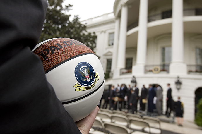 A guest holds a souvenir basketball at a ceremony honoring the 2009 NCAA basketball champions University of North Carolina Tar Heels in front of the South Portico of White House