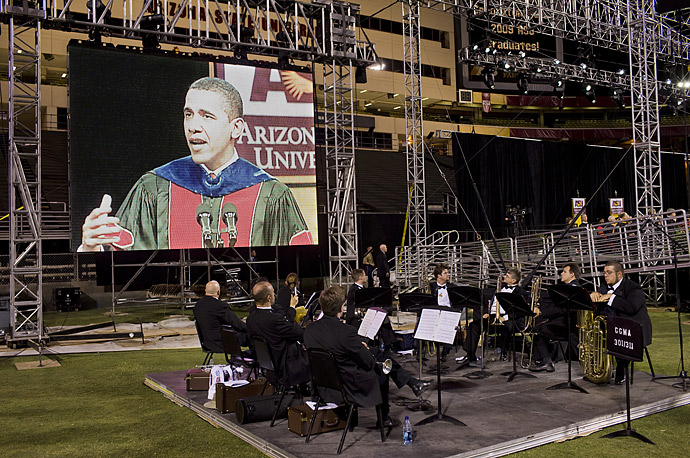 A university band listens,  as President Barack Obama speaks at the Arizona State University commencement ceremony at Sun Devil Stadium in Tempe, Ariz.