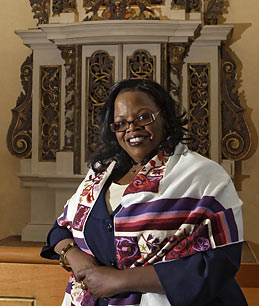 Alysa Stanton poses in front of an ark in the synagogue at Hebrew Union College, Thursday, May 21, 2009, in Cincinnati. Stanton is to be ordained June 6 as mainstream Judaisms first black woman rabbi.