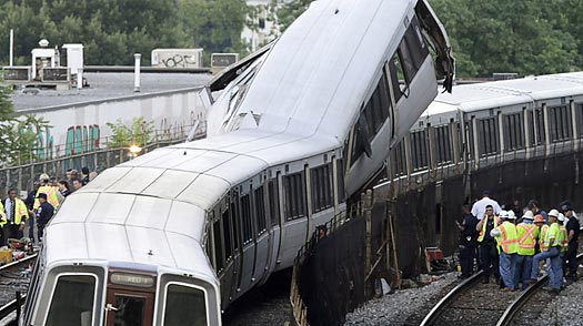 People work at the scene where rush-hour Metro trains crashed in Washington, D.C., on June 22