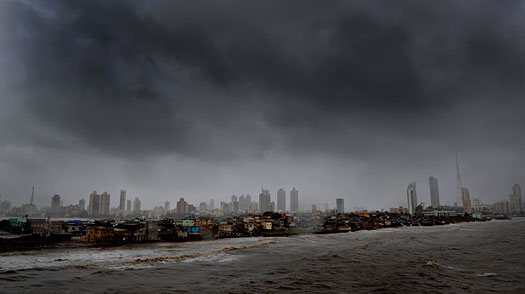Dark clouds hover over the Mumbai skyline on June 23, 2009