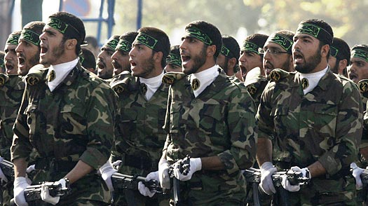 A photo of Basij volunteers drilling in their drill uniforms.  (Credit: Vahid Salemi / AP)