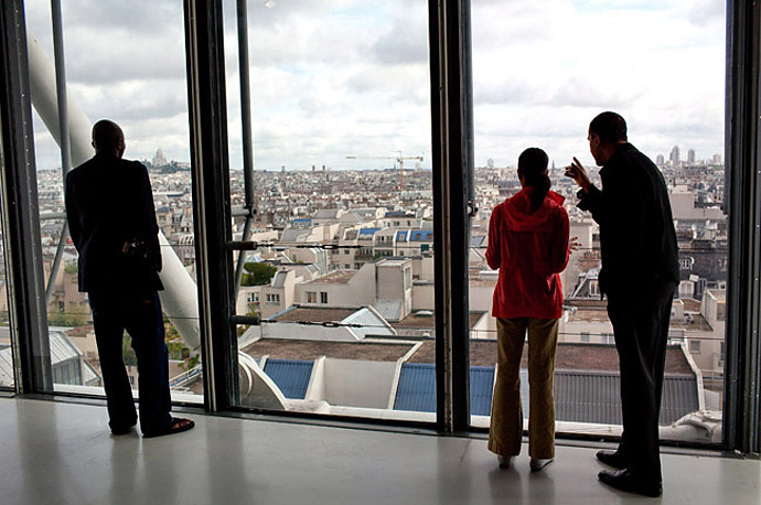 President Barack Obama points out a landmark to daughter Malia while touring the Pompidou Centre modern art museum in Paris France