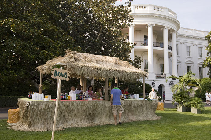 A Hawaiian style bar is set up on the South Lawn as U.S. President Barack Obama hosts a luau at the White House