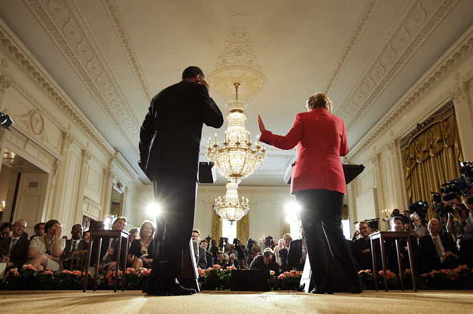 President Barack Obama and German Chancellor Angela Merkel participate in a joint news conference in the White House.