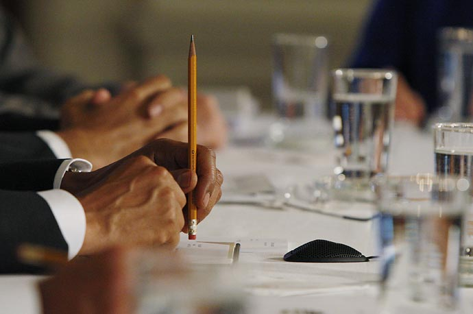 President Obama holds a pencil as he participates in a cabinet meeting.