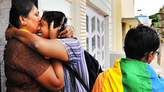 Members of the Indian homosexual community embrace each other as they celebrate the New Delhi High Court ruling decriminalising gay sex, in Bangalore on July 2, 2009