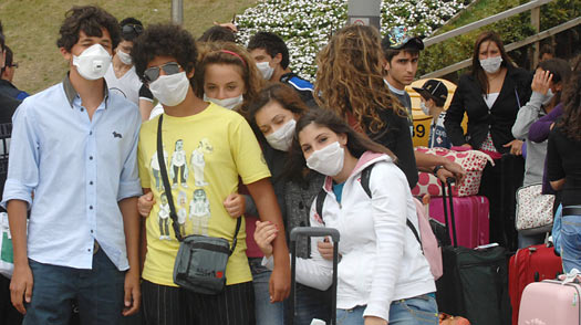 Italian students arrive at England's Standsted Airport wearing masks to protect against swine flu