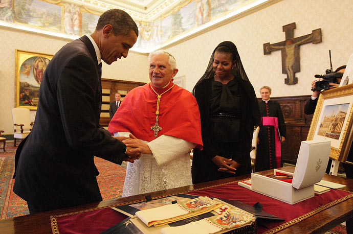 At their first meeting, President Barack Obama and First Lady Michelle Obama exchange gifts with Pope Benedict XVI in his library at the Vatican.