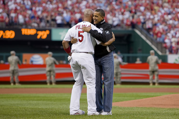 U.S. President Barack Obama embraces St. Louis Cardinals baseball player Albert Pujols after Obama threw the ceremonial first