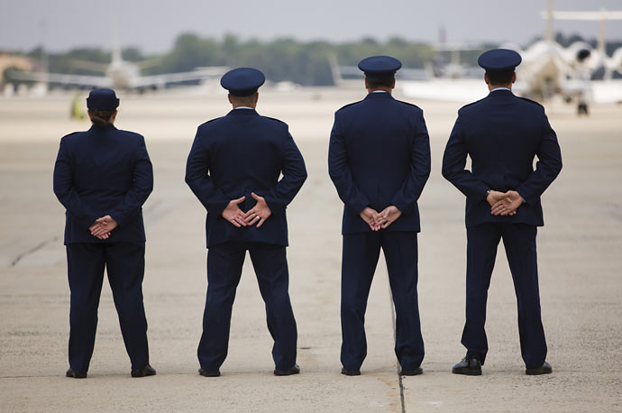 U.S. Air Force personnel await the arrival of Marine One carrying Barack Obama to Air Force One at Andrews Air Force Base