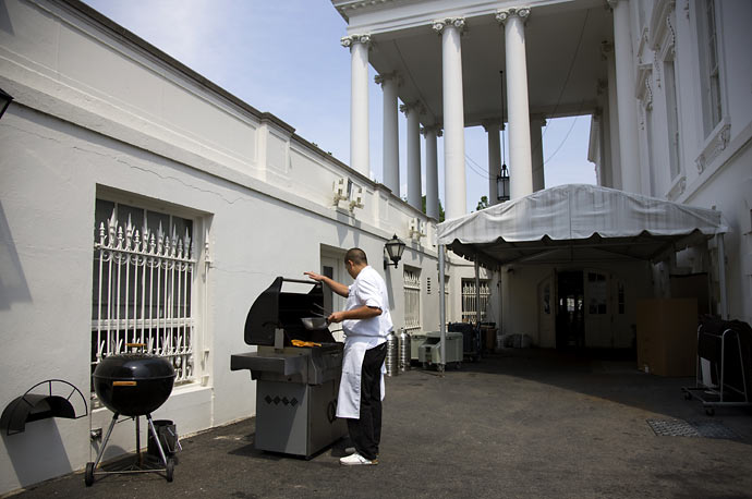 A White House chef grills chicken near the north portico of the White House in Washington.