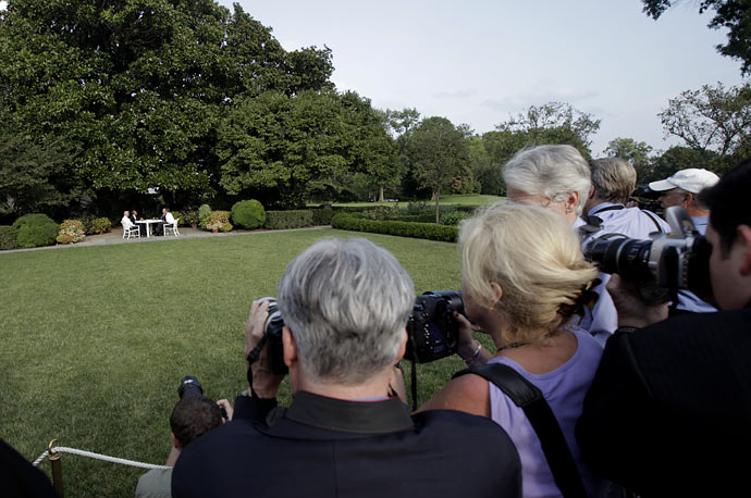 The media watches as President Obama (right) sits down for a beer in the Rose Garden with (left to right) Vice President Biden, Henry Louis