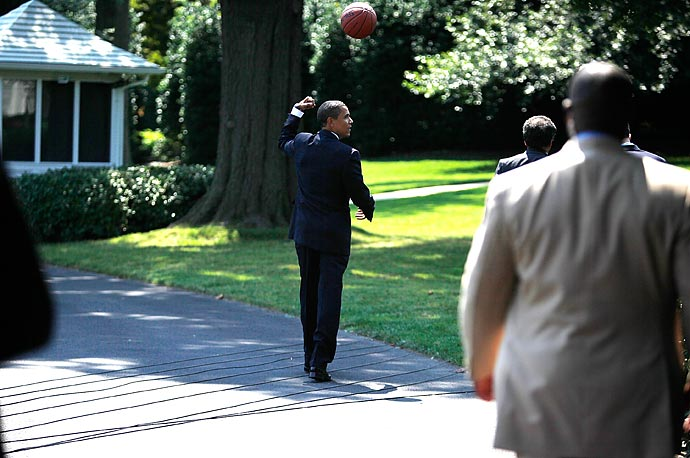 President Obama throws a basketball to a staff member after he hosted the Detroit Shock at the South Portico of the White House.