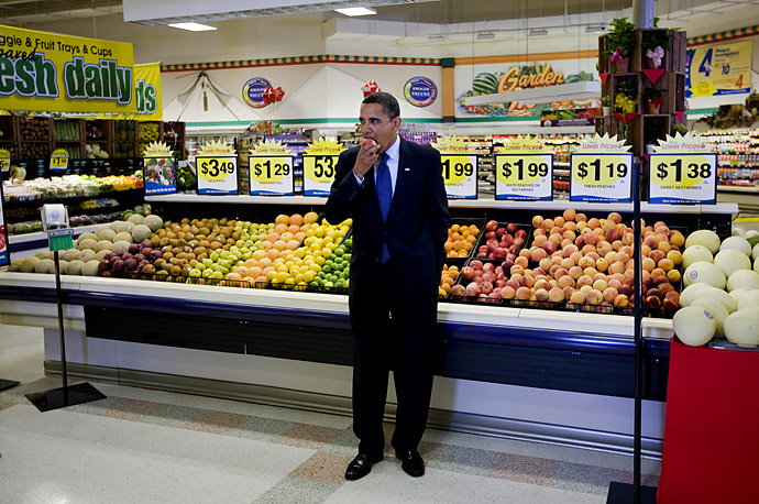 President Obama eats a piece of fruit after a town hall meeting on health care in a Kroger supermarket in Bristol, Va. peach