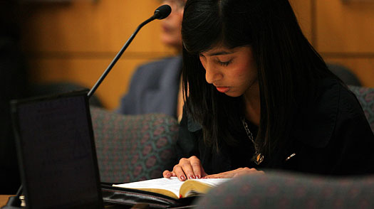 Rifqa Bary, 17, reads a Bible during her court proceedings in Orlando, Fla., on Aug. 21, 2009