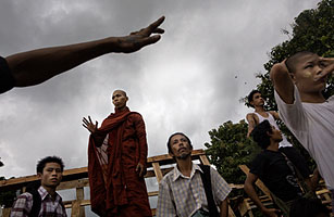 Protesters stand near a road block in Rangoon, Burma, on September 27, 2007