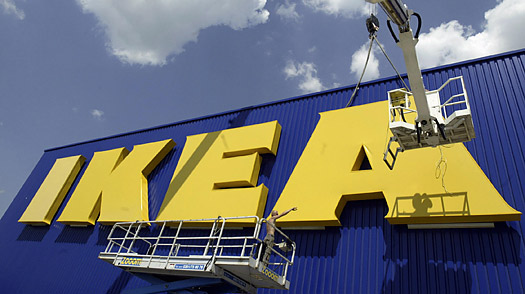 workers fixing the logo of Swedish furniture chain Ikea on a new built store in Schmira, eastern Germany.