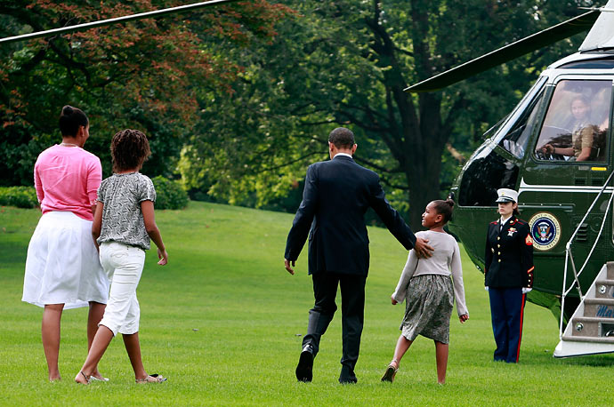 President Obama (second from right) and first lady Michelle Obama (left) walk with daughters Sasha (right) and Malia (second from left)
