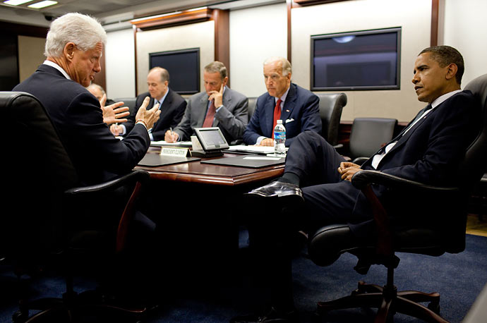 President Barack Obama (right) meets with former President Bill Clinton (left) in the Situation Room of the White House to discuss North Korea.