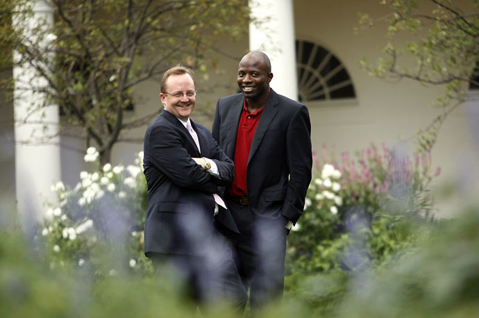 White House press spokesman Robert Gibbs (left) and President Obama's personal aide Reggie Love talk in the Rose Garden of the White House.
