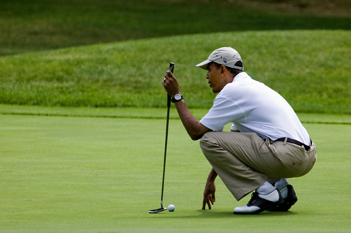 President Obama plays golf at Mink Meadows Golf Club in Vineyard Haven, Massachusetts on Martha's Vineyard.
