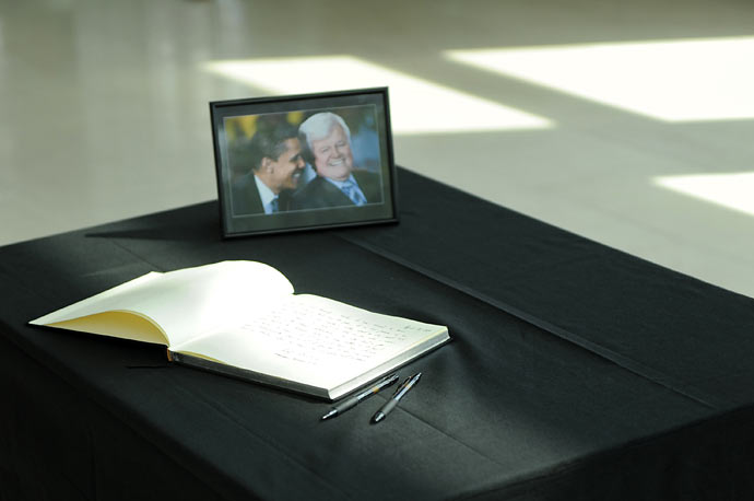A book in which people can pay their respects to the late US-Senator Edward Kennedy is displayed next to a photo showing him with