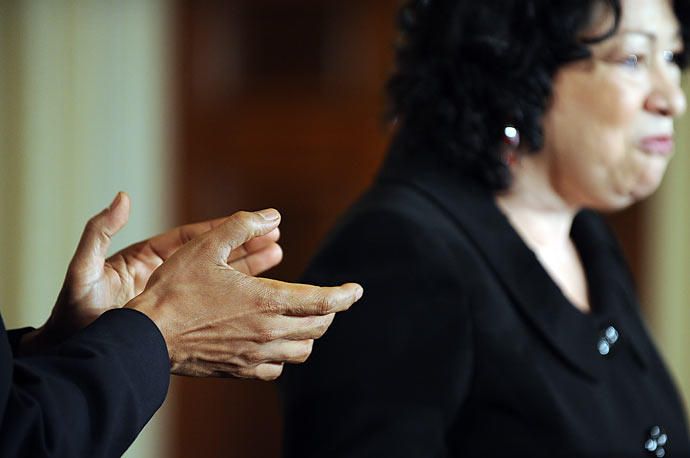 President Obama applauds as Justice Sonia Sotomayor speaks during a reception in her honor in the East Room at the White House on August 12, 2009.