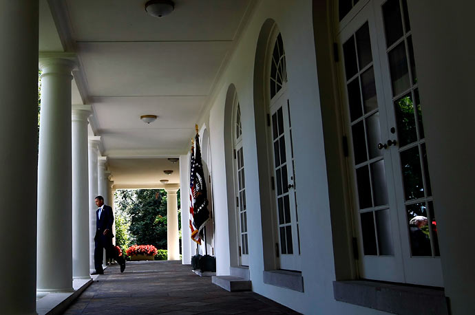 President Obama walks to the Rose Garden for a statement after meeting with senior government officials on preparedness and response