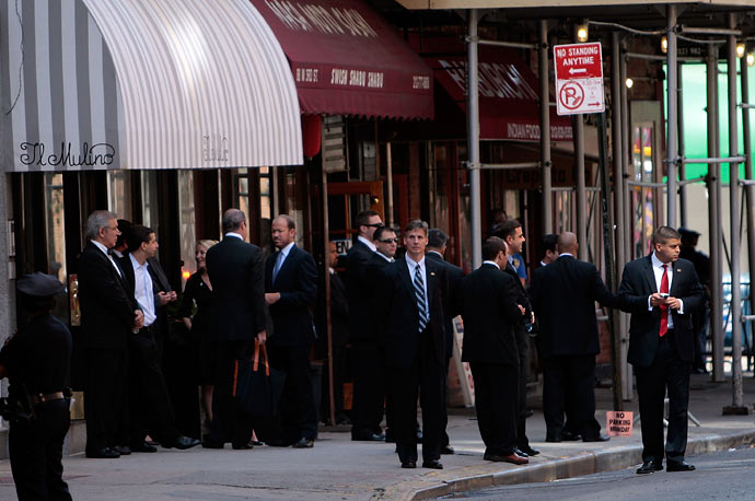 Security and officials wait outside New York City's Il Mulino restaurant for President Obama to arrive for lunch after he gave a speech on Wall Street earlier in the day.
