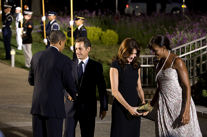 France's President Nicolas Sarkozy President Obama as France's first lady Carla Bruni-Sarkozy with first lady Michelle Obama at the Phipps Conservatory before an  the G20 Summit in Pittsburgh.