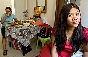 Two Filipino women in the flat they rent in Tel Aviv. Like many other Filipino migrant workers in Israel, the two women work are care givers to the elderly.