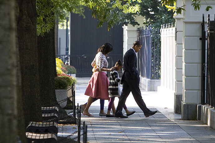 U.S. President Barack Obama (R), First Lady Michelle Obama (2nd L) and their daughters Sasha (2nd R) and Malia walk to the White House after Sunday morning Service at St. John's Church in Washington