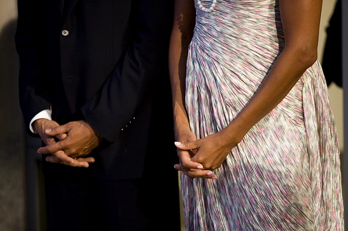 The Obama's wait for arriving leaders at the Phipps Conservatory, before an opening reception and working dinner for heads of delegation, at the G20 Summit in Pittsburgh, Pennsylvania.